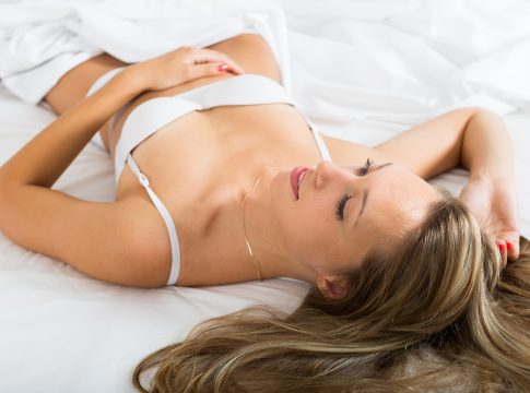 Girl in underwear on bed